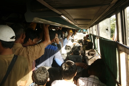 crowded bus filled with passengers in Indonesia  Editorial