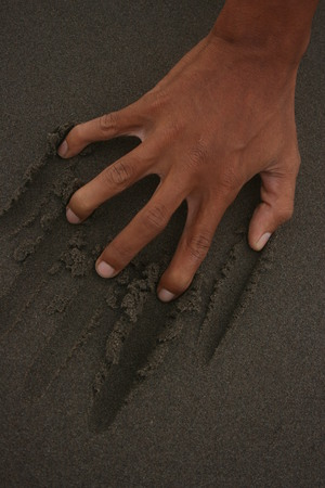 clawed: Clawed Hand on the beach sand