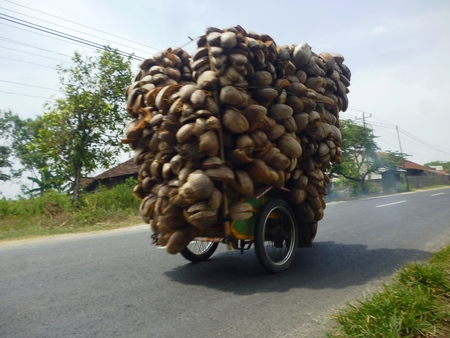 a motorist carry its load overload  Stock Photo