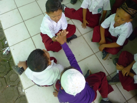 Happy School Children Play playing cards