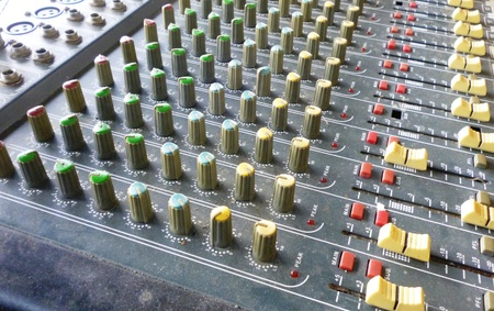 Side closeup on a sliders of a mixing console. It is used for audio signals modifications to achieve the desired output. Applied in recording studios, broadcasting, television and film post-production photo