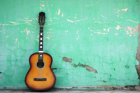 leaned: Guitar leaned to a blue wall