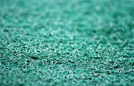 Closeup view of blue carpet. Fluffy blue background, on the deepth of field photo