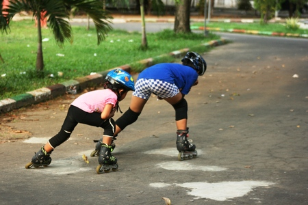 rollerskater: Little girl in roller skates at a park in Indonesia, asian