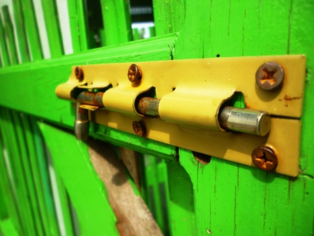 pent: lock key with green wood background