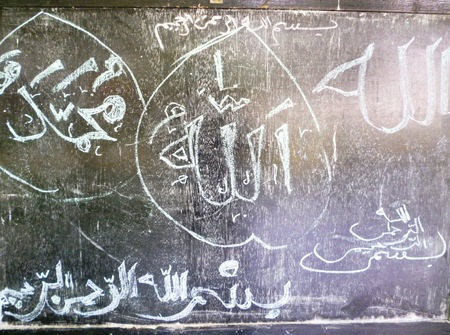 chalky: Chalky arabian language with white chalk on old blackboard