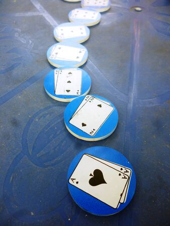 earns: round playing poker coins isolated blue  background