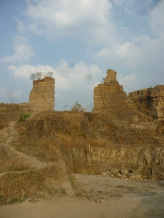 als: brown rock formations and walls with deep sky, known als brown Canyon, semarang, central java, indonesia