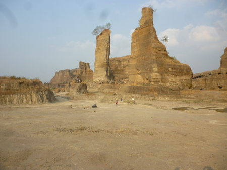 canyon walls: brown rock formations and walls with deep sky, known als brown Canyon, semarang, central java, indonesia