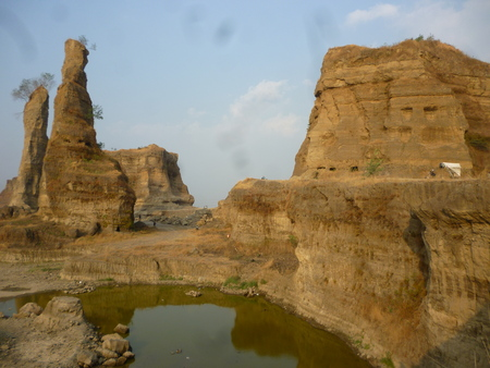 als: brown rock formations and walls with deep sky, known als brown Canyon, semrtang, central java, indonesia Stock Photo