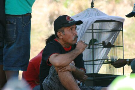 bout: old man enjoy in bird call contest in indonesia