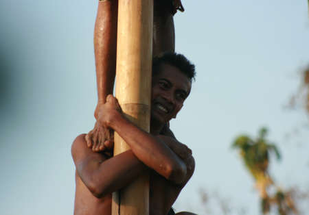 commemorating: Male Indonesian bamboo pole climbing wet slippery for prizes in a ceremony commemorating the Indonesian Independence Day every August 17 Editorial
