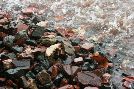 selective focus: Heavy rain on gravel Stock Photo