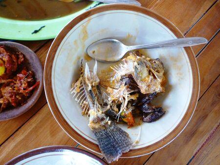 leftovers: Fish bones on plate Stock Photo