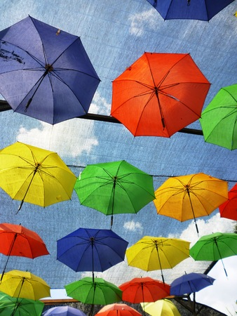 asian house plants: sky umbrellas give a guarantee that the rain will not spoil the day, in restaurant, Indonesia. Stock Photo