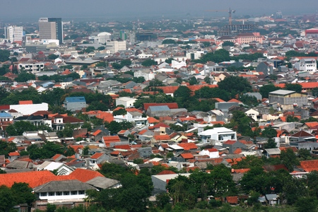 floodlit: cityscape of Semarang from agung mosque tower, capital of Central Java, Indonesia Stock Photo