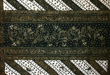 south east asian: batik hand stamp print with it its intricasy in the design motif batik is commonly worn in cirebon, lasem, and indramayu , indonesia, south east asian