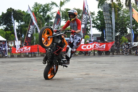 attractions daring freestyle of motorcycle rider, asian, indonesia