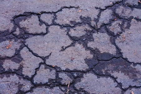blacktop: cracked asphalt road