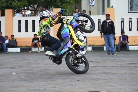 freestyle: attractions daring freestyle of motorcycle rider, asian, indonesia