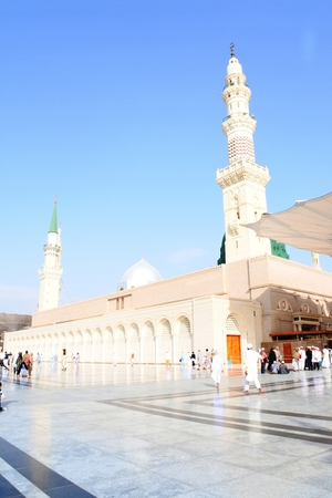 worshiped: MEDINA, SAUDI ARABIA KSA - February 28 Muslims get ready to pray around Nabawi Mosque February 28, 2017 in Medina, KSA Muslims from all over the world visit this place would do