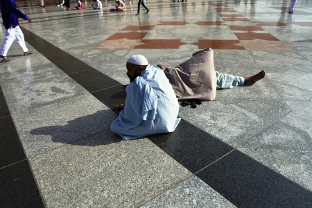 civilizing: MEDINA, SAUDI ARABIA KSA - February 28 Muslims get ready to pray around Nabawi Mosque February 28, 2017 in Medina, KSA Muslims from all over the world visit this place would do