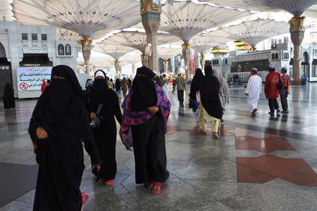 MEDINA, SAUDI ARABIA KSA - February 28 Muslims get ready to pray around Nabawi Mosque February 28, 2017 in Medina, KSA Muslims from all over the world visit this place would do