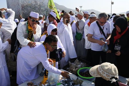 overthrown: MECCA, SAUDI ARABIA - MARCH 6: Muslims at Mount Arafat or Jabal Rahmah March 5, 2017 in Arafat, Saudi Arabia. This is the place where Adam and Eve (Adam and Hawa) met after being overthrown from heaven.