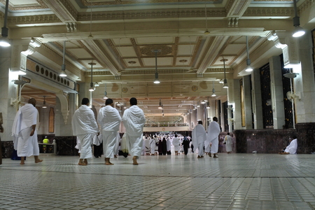 MECCA - March 5, 2017: Muslim pilgrims perform saei brisk walking from Safa hill from Marwah hill on March 5, 2017 in Mecca Saudi Arabia. Muslim pilgrims perform 7 rounds of saei from Safa to Marwah hill.