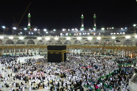 Muslim pilgrims, from all around the World, revolving around the Kaaba at night