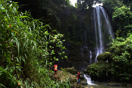 pasucen Waterfall in a lush rainforest. Beautiful waterfalls or cascades in Gunem, Rembang, central java, Indonesia