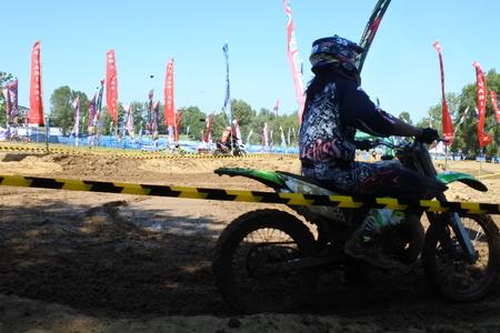 motorcross: Motocross racer accelerating in dust track