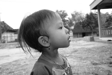 jah: Blora, INDONESIA - APR 8: children in his village (bw photo) on Apr 8, 2017 in Blora, Indonesia live below the poverty Editorial