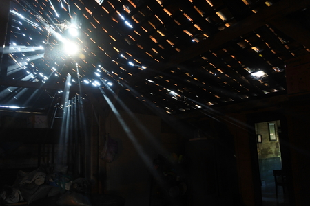 ray of light passes through the roof of the house Banco de Imagens