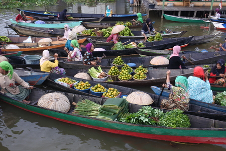 traders at the Floating Lok Baintan market in the morning, Banjar, South of Kalimantan