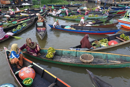 traders at the Floating Lok Baintan market in the morning, Banjar, South of Kalimantan