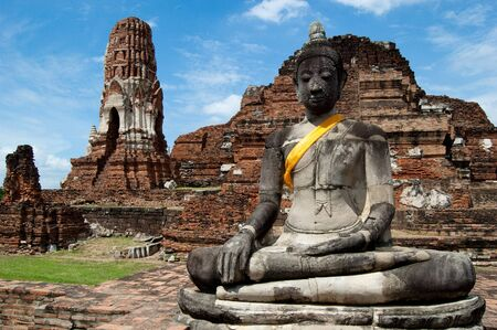 A statue of Buddha sits in meditation in the ruins of Ayutthaya, a Unesco World Heritage Site Stock Photo