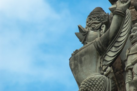 The mythical garuda bird stands watch over a temple in Ayutthaya.