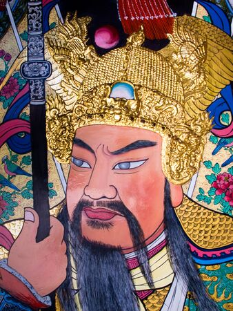 Colourful guardian painted on a door of a Chinese temple