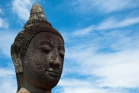 A serene Buddha meditates over the ruins of Ayutthaya.