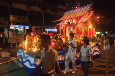 Penang, Malaysia, 26 October 2009. Devotees escort a festive float carrying one of the nine Emperor Gods in a procession to the sea shore. The Festival of the Nine Emperor Gods is an annual Taoist celebration observed in Southeast Asia.