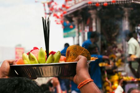 Penang, Malaysia, Feb 2 2009. A devotee offers a plate of fruit and sweets to the chariot of Murugan in the annual Thaipusam procession in Penang. Taken 2 Feb 2009.