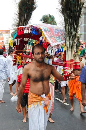 Penang, Malaysia, Feb 2 2009. A devotee carrying a  decorated wooden frame or kavadi as a form of intercession to the Lord Murugan during the annual Thaipusam street procession in Penang. Taken 2 Feb 2009.