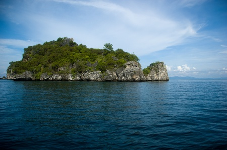 Tropical island getaways dot the blue Andaman Sea in Southern Thailand
