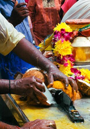 Devotee smashes a coconut offering during the annual Thaipusam festival in Penang