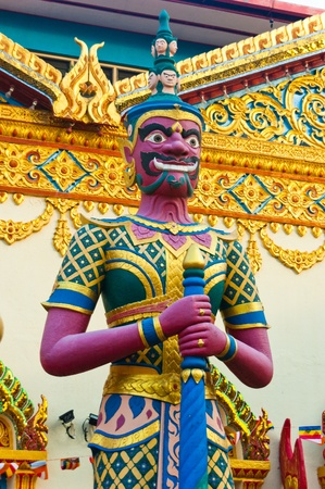 A colourful temple guardian outside the Sleeping Buddha Temple in Penang.