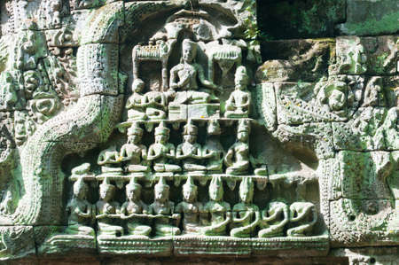 Carving of monks and holy men sitting in prayer and meditation.