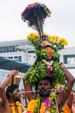 20 January 2011, Kuala Lumpur, Malaysia: A Hindu devotee walks with a skewered mouth as part of a popular devotion during the anual Thaipusam festival.