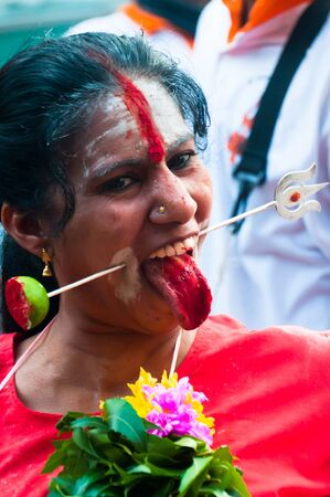 20 January 2011, Kuala Lumpur, Malaysia: A female Hindu devotee possessed by a spirit and skewered during the annual Thaipusam festival.