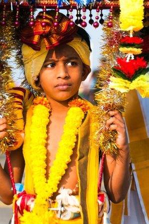 ritual: 20 January 2011, Kuala Lumpur, Malaysia: A young boy devotee carrying the ceremonial kavadi as part of a thanksgiving ritual during the annual Thaipusam festival.